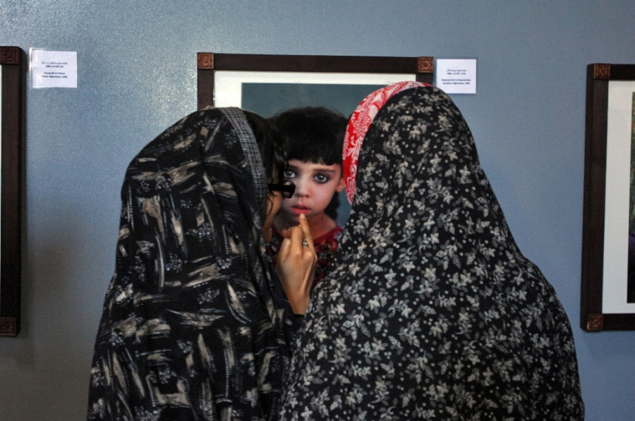 Herat women looking at picture, 2009