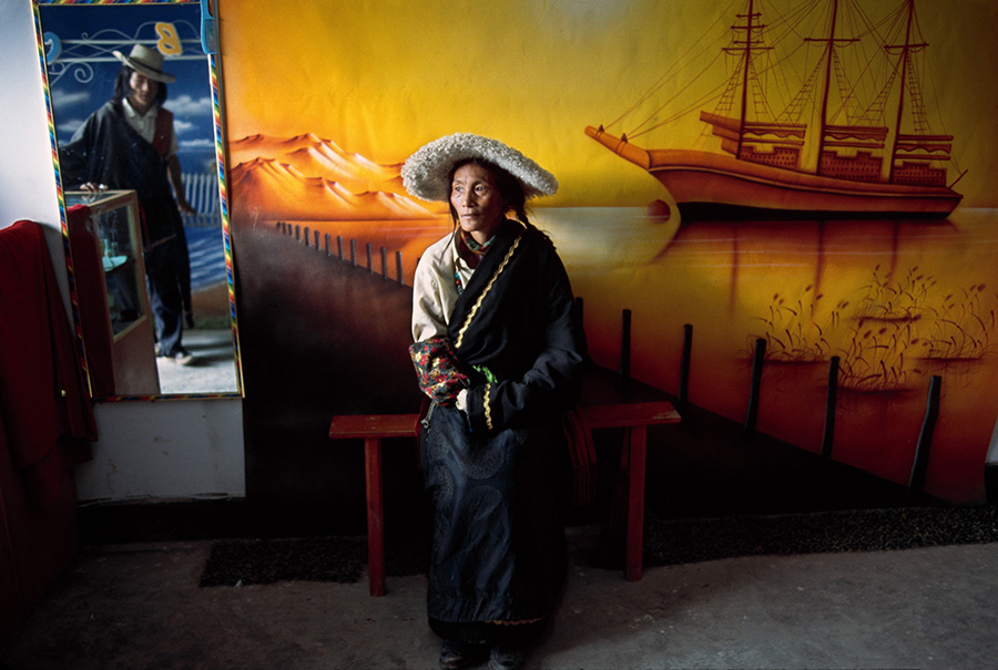 00202_ 20, Woman in Photography Studio in Lhasa, Tibet, Tibetans, 09/2001, 2001