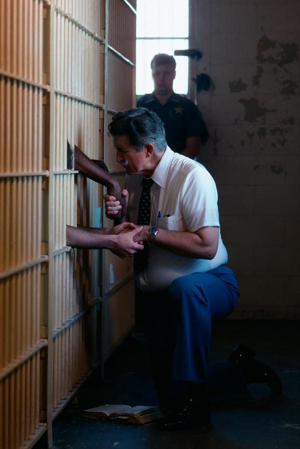 Prison preacher Jimmy Swaggart talks to inmates, Lakeland, Florida