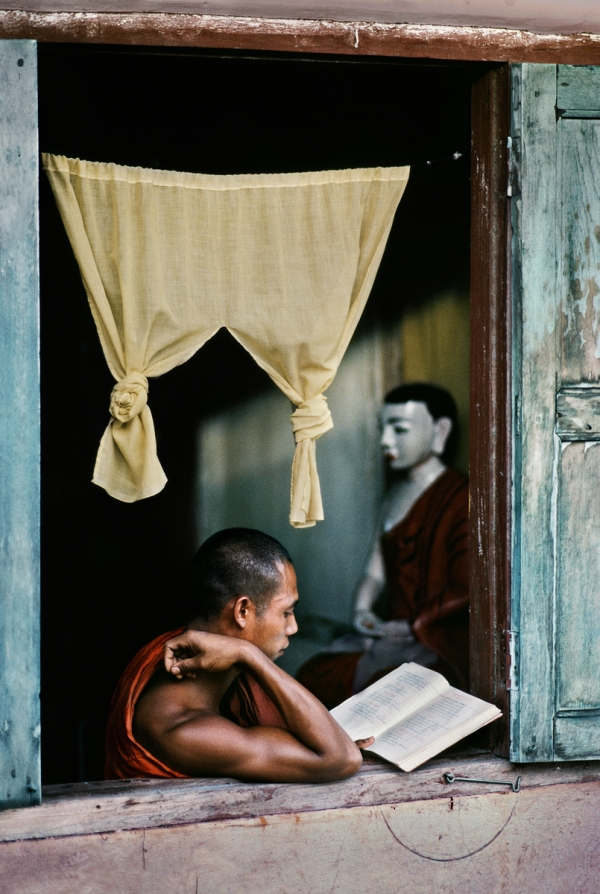 Monk reads Buddhist scripture at monastery in Rangoon, Myanmar (Burma), 1985