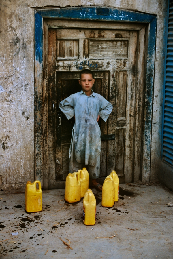 00299_01, Kabul, Afghanistan, 2002, AFGHN-12432. A water vendor poses.