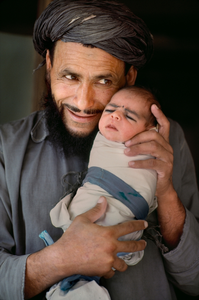 AFGHN-13293, Afghanistan, 1984. A man holds a baby.