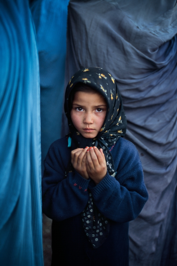 Girl praying at a Shia mosque, Kabul, Afghanistan, 2003, final book_iconic
