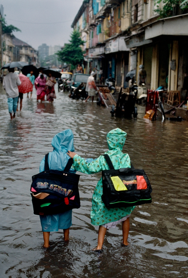 01873_17, Bombay, India, 09/1993, INDIA-12471NF. Two children walk through the flooded streets of Bombay after school.  retouched_Ekaterina Savtsova 10/30/2014