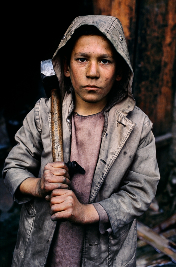 00284_14, Charikar, Afghanistan, 2002, AFGHN-10211. A young miner holds a hammer. NYC65502, MCS2002002 K296 Kabul, Afghanistan, 2002. Pg 236, Untold: The Stories Behind the Photographs. final print_milan PORTRAITS_book final print_MACRO retouched_Sonny Fabbri 4/18/2013
