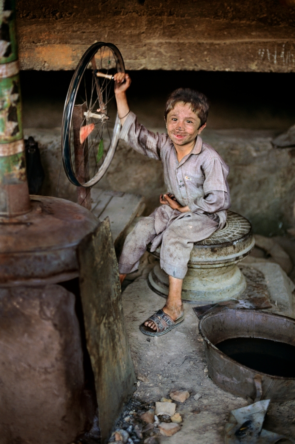 A young boy works in a mill in Pul-i- Khumri, Afghanistan, 1992, final print_milan final print_MACRO