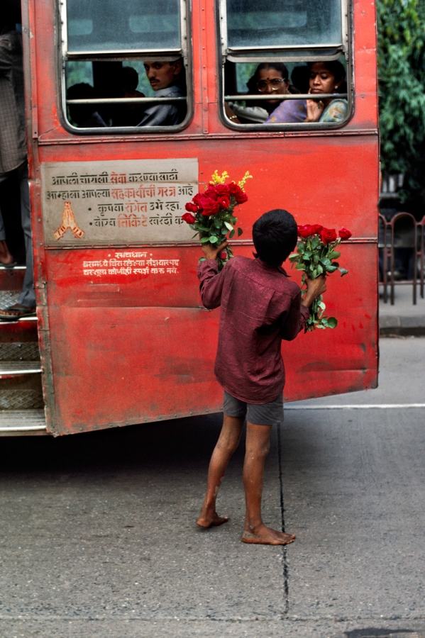 00075_15, Bombay, India, 1993, INDIA-10680NF. A young boy selling flowers. India_Book retouched_Sonny Fabbri 02/25/2015