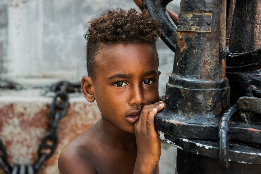 _DSC9065, Cuba. 7/18/2015. Portrait of a young boy next to a scuplture. retouched_Ekaterina Savtsova 08/02/2015