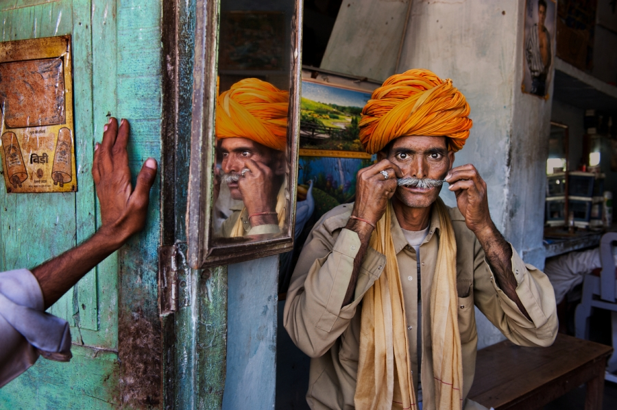 SAM_5899, Rajasthan, India, 2009, INDIA-11532. Man adjusting his mustache. MAX PRINT SIZE: 30X40 India_Book retouched_Sonny Fabbri 02/11/2015