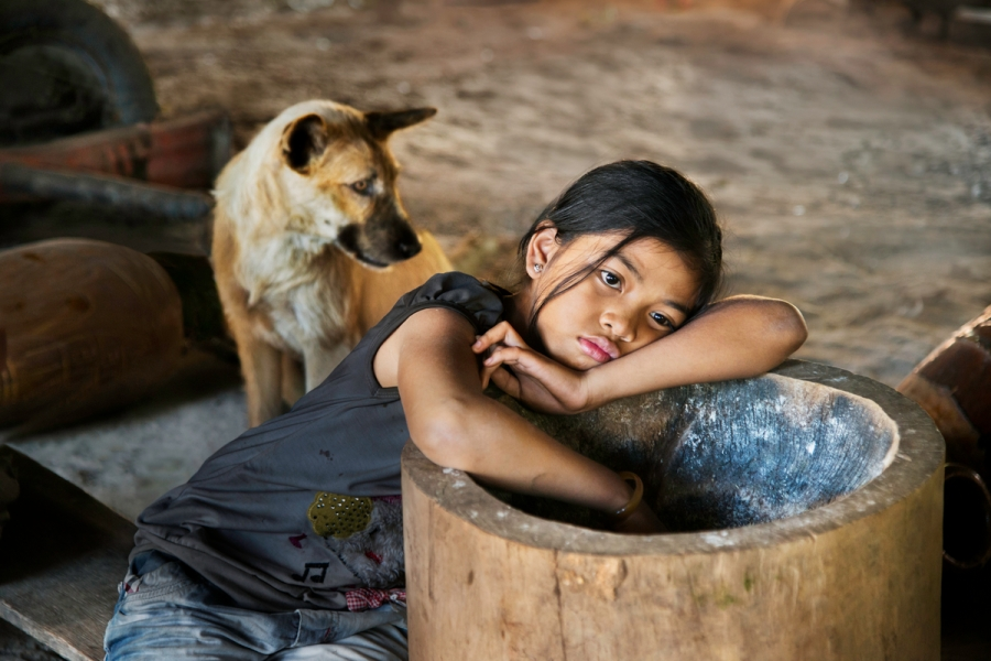 DSC_4040, Lavazza, Vietnam, 2013, VIETNAM-10087. A girl with a dog resting. MAX PRINT SIZE: 40x60 Coffee_Book retouched_Sonny Fabbri 10/15/2014 From These Hands. A Journey Along the Coffee Trail. Phaidon Press Limited.