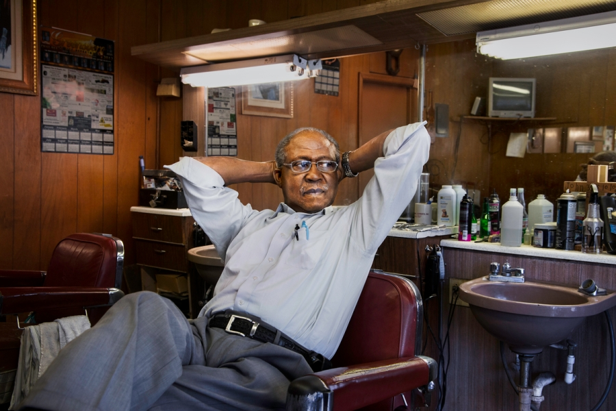 _DSC9480, Deep South, Alabama, USA, 2013, USA-10795. Barber Eugene Lyles relaxes in his shop. Final Deep South selection for Smithsonian_web Retouched_Sonny Fabbri 07/31/2015