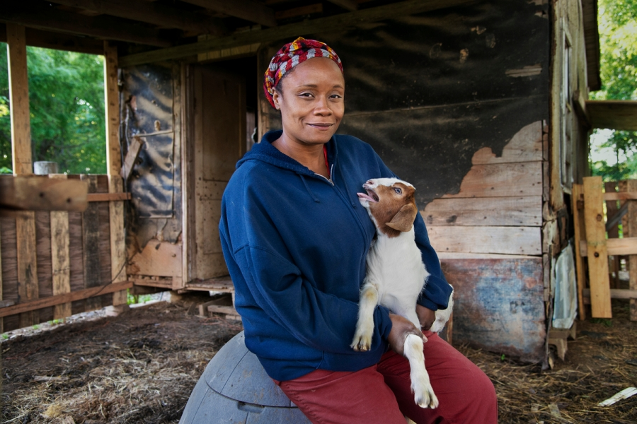 _DSC5744, Deep South, outside Palestine, Arkansas, USA, 04/2014, USA-10943. Delores Walker Robinson holds a goat on her cattle farm. CHECK IMAGE USAGE Final Deep South Selection_Smithsonian Online Publication Retouched_Sonny Fabbri 7/15/2015