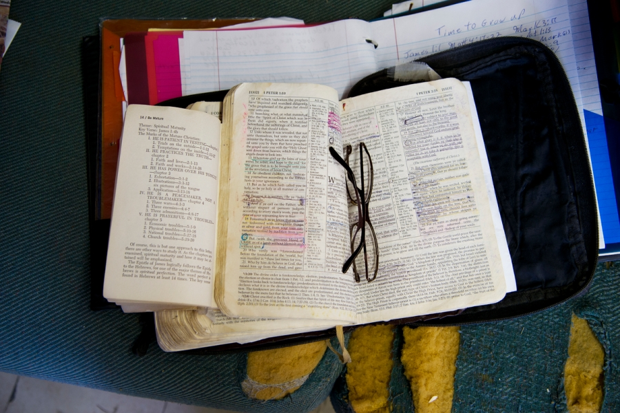 DSC_3178, Deep South, USA, 09/2013, USA-10972. Reverend Lyles's annotated Bible, on the desk in his barbershop retouched_Sonny Fabbri 7/15/2015 Deep South_Book_HMH