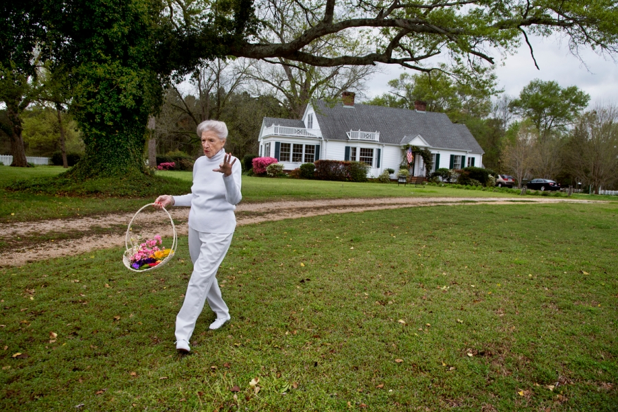 DSC_5648, Deep South, Greensboro, Alabama, USA, 04/2014, USA-11019NF. Janet May walking with a basket of flowers. Retouched_Sonny Fabbri 7/15/2015