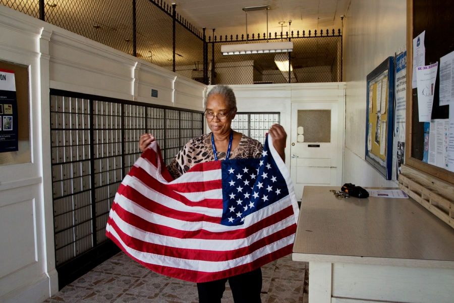 DSC_6664, Deep South, Arcola, Mississippi, United States, 04/2014, DSC_6753, DSC_6803, DSC_6804, USA-11060. A woman folds the American flag. retouched_Sonny Fabbri 7/15/2015