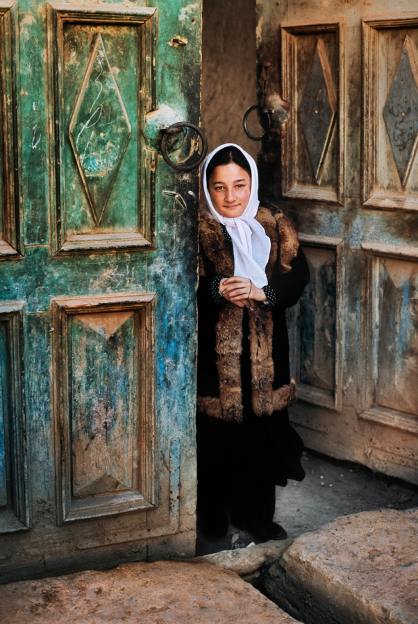 AFGHN-12467NF, Kabul, Afghanistan, 2002, AFGHN-12467NF. Girl standing in the doorway of her home. This young girl lives in the ancient part of Kabul, which until the past decade was almost destroyed due to decades of war. Organizations like Turquoise Mountain (@TurquoiseMountain) are restoring parts of the old city, and are working to re-imagine and resurrect almost-forgotten crafts in order to provide people with skills which will enable them to have gainful employment. retouched_Sonny Fabbri 03/04/2015