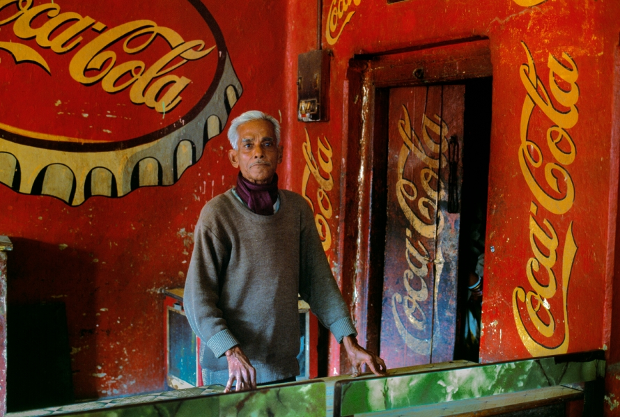 Man immersed in American consumerism, Bodh Gaya, Bihar, India, 2000. Magnum Photos, NYC31911, MCS2003002 K019