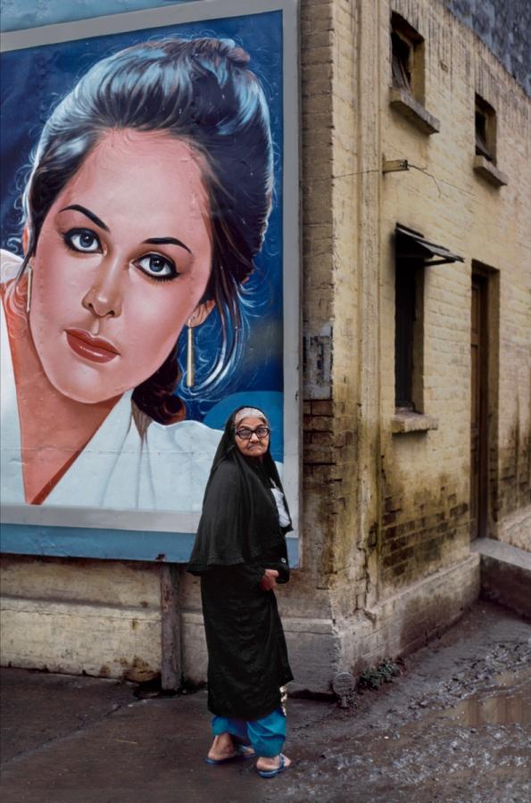 00313_20, Decca to Peshawar, 1983, Rawalpindi, Pakistan, PAKISTAN-10101. A woman in front a of a mural. retouched_Ekaterina Savtsova 03/21/2014