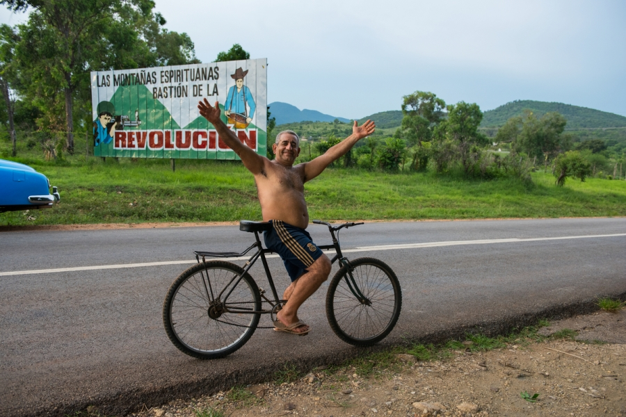 _DSC0234, Cuba. 07/19/2015, CUBA-10280NF. A man on bicycle with arms outstretched. retouched_Ekaterina Savtsova 08/28/2015