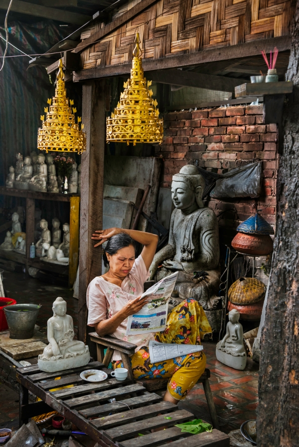 DSC_1841, Myanmar/Burma, 2013, BURMA-10685. A woman reads a newspaper in her shop. Coffee_Book retouched_Sonny Fabbri 09/09/2015