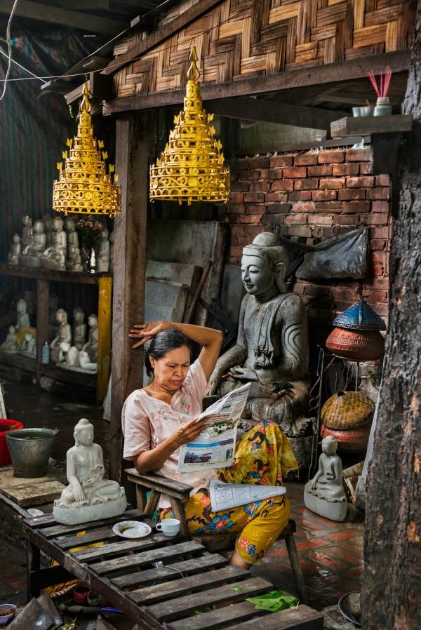 DSC_1841, Myanmar/Burma, 2013, BURMA-10685. A woman reads a newspaper in her shop. Coffee_Book retouched_Sonny Fabbri 09/09/2015